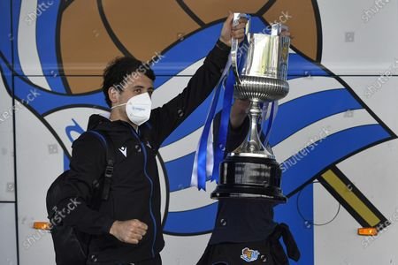 Real Sociedad's Asier Illarramendi and Mikel Oyarzabal, left, hold the trophy after winning Copa del Rey final soccer match, while arriving at regional airport in Fuenterrabia, 24 km from San Sebastian (14,9 miles), northern Spain, . Real Sociedad won yesterday April 3 Copa del Rey soccer match against Athletic Bilbao 1-0