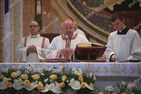 Cardinal Stanislaw Dziwisz (C) presides over the Easter Eucharist at the Sanctuary of Saint John Paul II in Lagiewniki, Krakow, Poland, 04 April 2021. Easter is celebrated around the world by Christians to mark the resurrection of Jesus from the dead and the foundation of the Christian faith.