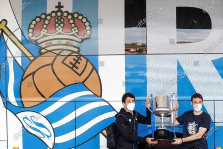 Stock Picture of Real Sociedad's Asier Illarramendi (R) and Mikel Oyarzabal (L) show the 2020 Spanish King's Cup trophy upon arrival at Hondarribia airporti, in San Sebastian, Basque Country, Spain, 04 April 2021, after winning the King's Cup final soccer match against Athletic Club de Bilbao at La Cartuja stadium in Seville.