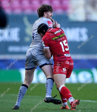 Stock Photo of Scarlets vs Sale Sharks. Sale's Simon Hammersley is tackled by Leigh Halfpenny of Scarlets
