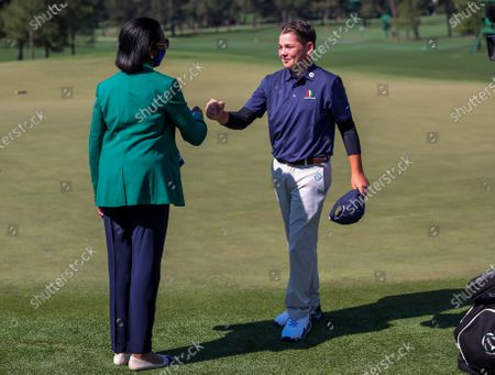 Boys 10-11 winner Brady Barnum (R) of Ohio is greeted by former US Secretary of State Condoleezza Rice (L) during the Drive, Chip & Putt Championship at the 2021 Masters Tournament at the Augusta National Golf Club in Augusta, Georgia, USA, 04 April 2021. The 2021 Masters Tournament is held 08 April through 11 April 2021.