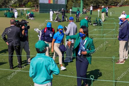 Stock Image of Former US Secretary of State Condoleezza Rice (R) greets young competitors during the Drive, Chip & Putt Championship at the 2021 Masters Tournament at the Augusta National Golf Club in Augusta, Georgia, USA, 04 April 2021. The 2021 Masters Tournament is held 08 April through 11 April 2021.