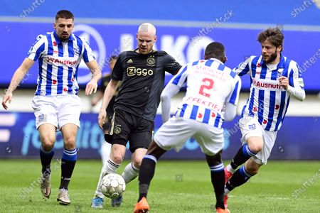 (L-R) - Ibrahim Dresevic of SC Heerenveen, Davy Klaassen of Ajax, Sherel Floranus of SC Heerenveen, Lasse Schone or SC Heerenveen in action during the Dutch Eredivisie soccer match between SC Heerenveen and Ajax at the Abe Lenstra Stadium in Heerenveen, The Netherlands, 04 April 2021.
