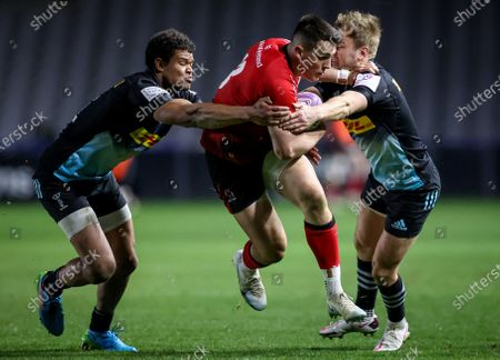 Harlequins vs Ulster. Ulster's James Hume comes up against Nathan Earle and Scott Steele of Harlequins