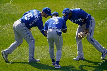 Toronto Blue Jays Randal Grichuk, left, Jonathan Davis, center, and Teoscar Hernandez, right, celebrate after defeating the New York Yankees in a baseball game, at Yankee Stadium in New York