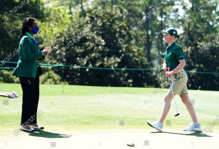 Stock Photo of Former Secretary of State and Augusta National Member Condoleezza Rice gives a thumbs up to Alexis Card after she won her age group in the Drive, Chip and Putt National Championship at Augusta National in Augusta, Georgia on Sunday, April 4, 2021. Photo by Kevin Dietsch/UPI