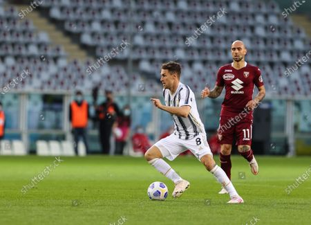 Stock Image of Aaron Ramsey of Juventus FC in action during the 2020/21 Italian Serie A football match between Torino FC and Juventus FC at Stadio Olimpico Grande Torino. Final score; Torino 2:2 Juventus.