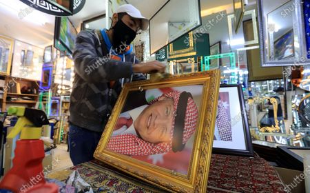 A frame maker in a frameshop displays a picture of king Abdullah II bin Al-Hussein king of Jordan, in Amman, Jordan, 04 April 2021, a day after several senior figures were detained and the half-brother of King Abdullah II prince Hamzah bin Hussein said that he was put under house arrest. Security agencies, through long-term and comprehensive joint investigations have been following activities and movements by His Royal Highness Prince Hamzah bin Al Hussein and others, said Deputy Prime Minister and Minister of Foreign Affairs and Expatriates Ayman Safadi in a press conference on 04 April.