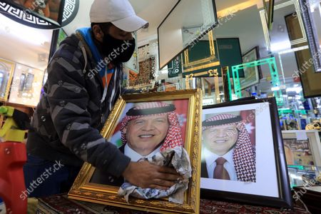 A frame maker in a frameshop displays pictures of king Abdullah II bin Al-Hussein king of Jordan, in Amman, Jordan, 04 April 2021, a day after several senior figures were detained and the half-brother of King Abdullah II prince Hamzah bin Hussein said that he was put under house arrest. Security agencies, through long-term and comprehensive joint investigations have been following activities and movements by His Royal Highness Prince Hamzah bin Al Hussein and others, said Deputy Prime Minister and Minister of Foreign Affairs and Expatriates Ayman Safadi in a press conference on 04 April.