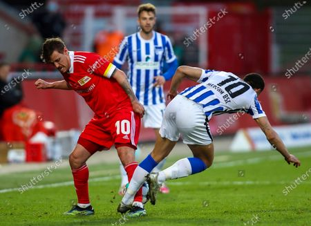 Union's striker Max Kruse, left, and Hertha's striker Matheus Cunha in action during their German Bundesliga soccer match in Berlin, Germany, . Union Berlin denied Hertha Berlin an important win as they battled to a hard-fought 1-1 draw in the Bundesliga, in its battle against relegation and Hertha reciprocated by denting its city rival's hopes of European qualification