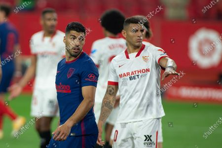 Luis Suarez of Atletico and Diego Carlos of Sevilla during LaLiga, football match played between Sevilla Futbol Club and Atletico de Madrid  at Ramon Sanchez Pizjuan Stadium on April 4, 2021 in Sevilla, Spain.