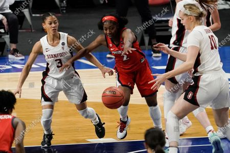 Arizona guard Aari McDonald (2) looks to grab a loose ball between Stanford guard Anna Wilson (3) and forward Alyssa Jerome (10) during the first half of the championship game in the women's Final Four NCAA college basketball tournament, at the Alamodome in San Antonio