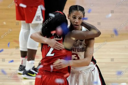 Arizona guard Aari McDonald (2) gets a hug from Stanford guard Anna Wilson (3) at the end of the championship game in the women's Final Four NCAA college basketball tournament, at the Alamodome in San Antonio. Stanford won 54-53