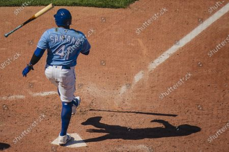 Kansas City Royals first baseman Carlos Santana #41 flips his bat after missing the Texas Rangers pitch in the 8th inning at Kaufman Stadium in Kansas City, Missouri on Sunday,