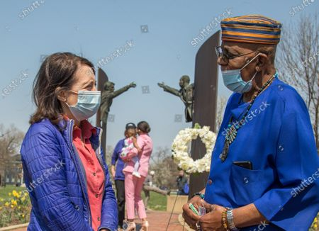 Senator Maria Cantwell, D-Wash, (left). listens to Reggie Jones in front of the Kennedy King Memorial in Indianapolis. Mr. Jones was present when Bobby Kennedy spoke at the spot shortly after Dr King's assassination on April 4, 1968. on Sunday April 4, 2021 in Indianapolis, Indiana.