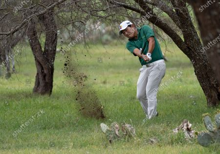 Sung Kang, from South Korea, hits during the final round of the Valero Texas Open golf tournament in San Antonio