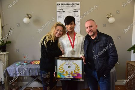 Fiona Gelin, Jeremy Bellet, Pascal Soetens. Presentation of the silver medal of the arts and the international culture of the short cinematographic film Jeremy Bellet for his film Un Dernier Souffle presented by Jean Eric Duluc president of the international tourism federation.