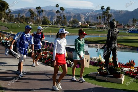 Lydia Ko of New Zealand and Gaby Lopez of Mexico, walk to the18th hole during the final round of the LPGA's ANA Inspiration golf tournament at Mission Hills Country Club, in Rancho Mirage, Calif