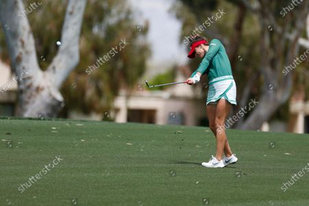 Gaby Lopez of Mexico hits from the fairway to the first hole during the final round of the LPGA's ANA Inspiration golf tournament at Mission Hills Country Club, in Rancho Mirage, Calif