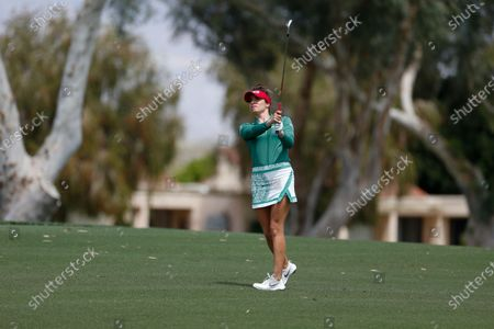 Stock Picture of Gaby Lopez of Mexico watches her shot from the fairway to the first hole during the final round of the LPGA's ANA Inspiration golf tournament at Mission Hills Country Club, in Rancho Mirage, Calif