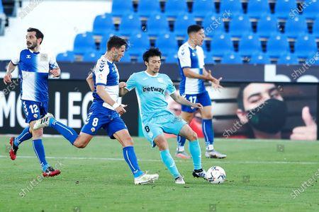 "(L-R) Adri Cuevas (Sabadell), Gaku Shibasaki (Leganes) - Football / Soccer : Spanish ""La Liga Smartbank"" match between CD Leganes 2-1 CE Sabadell FC at the Estadio Municipal de Butarque in Leganes, Spain."