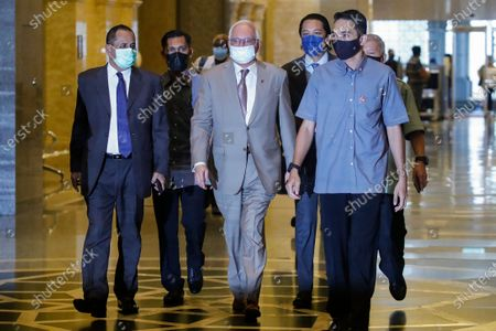Malaysia's former prime minister Najib Razak (C) arrives at the Court of Appeal in Putrajaya, Malaysia, 05 April 2021. Malaysia's Court of Appeal on 05 April will begin hearing a bid by Najib to set aside his conviction on corruption charges in a case linked to a multibillion-dollar scandal at state fund 1Malaysia Development Berhad (1MDB).