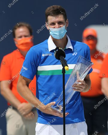 Hubert Hurkacz of Poland defeats Jannik Sinner of Italy during the men's singles final at the Miami Open at Hard Rock Stadium.