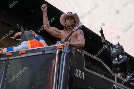 """Robert Burck, a.k.a """"Naked Cowboy"""", and his guitar attends the BusinessFunding.Com lunch event at Times Square in New York City."""