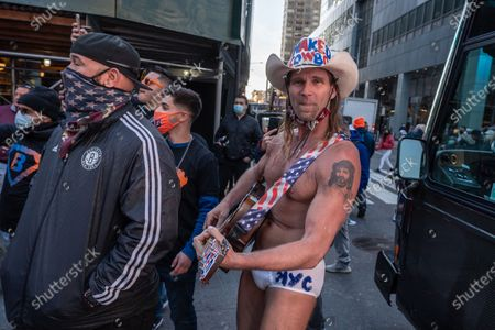 """Stock Picture of Robert Burck, a.k.a """"Naked Cowboy"""", and his guitar attends the BusinessFunding.Com lunch event at Times Square in New York City."""