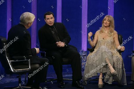 Michael Parkinson with John Travolta and Goldie Hawn.