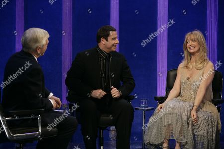 Michael Parkinson with John Travolta, and Goldie Hawn.