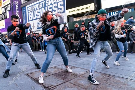 Stock Picture of BusinessFunding.com company held party launch on Times Square with performances by artists and advertisement on huge billboard. Company does lending to small businesses. Naked Cowboy, fixture of Times Square was also performing.