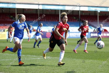 Lauren James of Manchester United Women and Emma Koivisto of Brighton and Hove Albion WFC during Barclays FA Women Super League match between Brighton and Hove Albion Women and Manchester United Women at The People's Pension Stadium on 04th April  , 2021 in Crawley, England