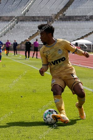 Stock Image of Angel Gomes in action during the game for Liga NOS between Belenenses SAD and Boavista FC, at Estadio Nacional, Lisboa, Portugal, 04, April, 2021