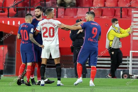 Diego Carlos of Sevilla CF and Luis Suarez of Atletico de Madrid during the La Liga match between Sevilla FC and Atletico de Madrid at Estadio Sanchez Pizjuan in Sevilla, Spain, on April 4, 2021.
