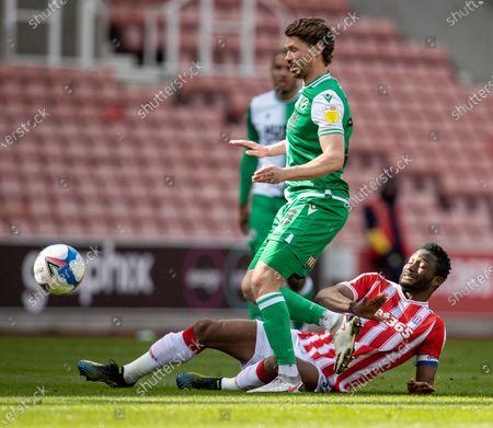 John Obi Mikel of Stoke City tackles George Evans of Millwall; Bet365 Stadium, Stoke, Staffordshire, England; English Football League Championship Football, Stoke City versus Millwall.
