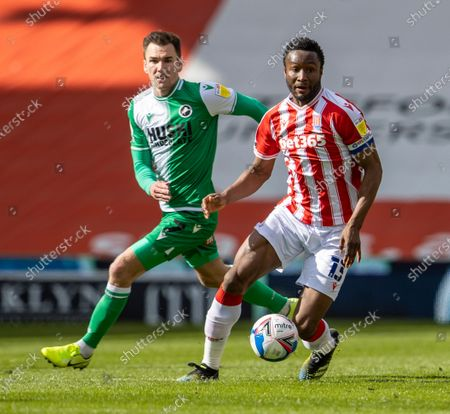 John Obi Mikel of Stoke City breaks away from Jed Wallace of Millwall; Bet365 Stadium, Stoke, Staffordshire, England; English Football League Championship Football, Stoke City versus Millwall.