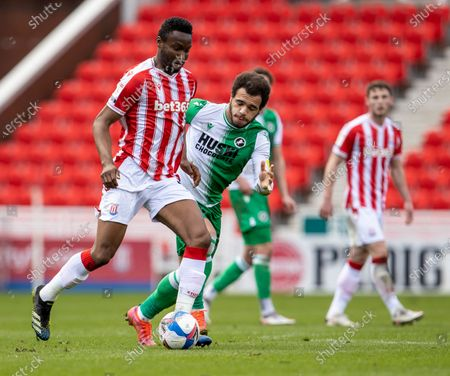 John Obi Mikel of Stoke City under pressure from Mason Bennett of Millwall; Bet365 Stadium, Stoke, Staffordshire, England; English Football League Championship Football, Stoke City versus Millwall.