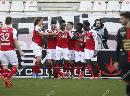 Ghislain Konan of Reims celebrates his goal with teammates