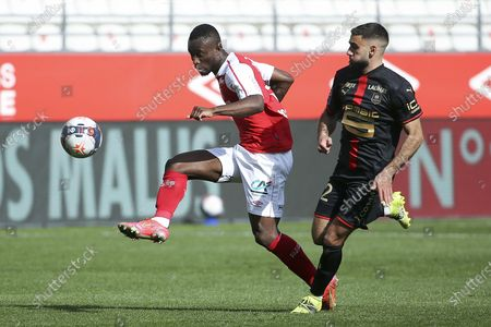 Stock Photo of Ghislain Konan of Reims, Romain Del Castillo of Rennes