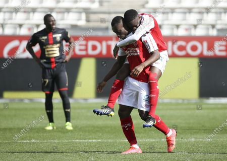 Ghislain Konan of Reims celebrates his goal with Moreto Cassama