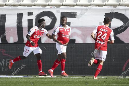 Ghislain Konan of Reims celebrates his goal with Nathanael Mbuku of Reims (left)