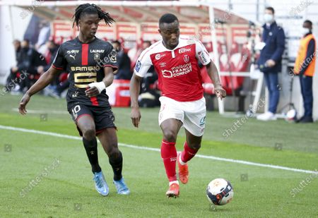 Ghislain Konan of Reims, Eduardo Camavinga of Rennes (left)