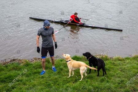 Picture dated April 3rd shows former Cambridge University rower and Olympian James Cracknell and BBC sports presenter Andrew Cotter with his world famous dogs Mabel and Olive by the River Great Ouse in Ely, Cambridgeshire on Saturday as they prepare for the broadcast of Sunday's Boat Race between Oxford and Cambridge University.