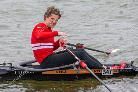 Stock Picture of Picture dated April 3rd shows former Cambridge University rower and Olympian James Cracknell on the River Great Ouse in Ely, Cambridgeshire on Saturday as he films a segment for the broadcast on this Sundays Boat Race between Oxford and Cambridge University.