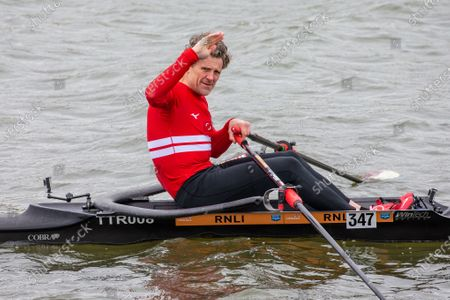 Stock Photo of Picture dated April 3rd shows former Cambridge University rower and Olympian James Cracknell on the River Great Ouse in Ely, Cambridgeshire on Saturday as he films a segment for the broadcast on this Sundays Boat Race between Oxford and Cambridge University.