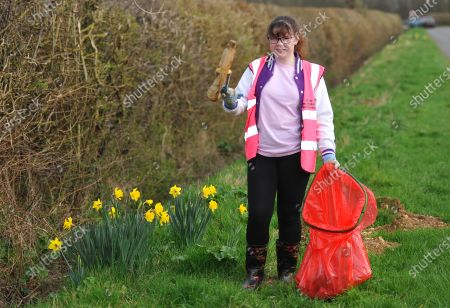 Stock Image of While some give up sweet treats or chocolate for Lent, one schoolgirl went on an extreme litter picking challenge - to honour the memory of Captain Sir Tom Moore. Heather Kent, 13, was horrified by the amount of rubbish on her local streets and the danger it can pose to animals.