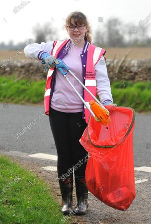 Stock Photo of While some give up sweet treats or chocolate for Lent, one schoolgirl went on an extreme litter picking challenge - to honour the memory of Captain Sir Tom Moore. Heather Kent, 13, was horrified by the amount of rubbish on her local streets and the danger it can pose to animals.