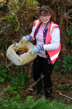 Stock Picture of While some give up sweet treats or chocolate for Lent, one schoolgirl went on an extreme litter picking challenge - to honour the memory of Captain Sir Tom Moore. Heather Kent, 13, was horrified by the amount of rubbish on her local streets and the danger it can pose to animals.