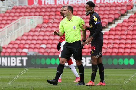 The referee Tim Robinson speaks to Watford midfielder Nathaniel Chalobah (14)  during the EFL Sky Bet Championship match between Middlesbrough and Watford at the Riverside Stadium, Middlesbrough